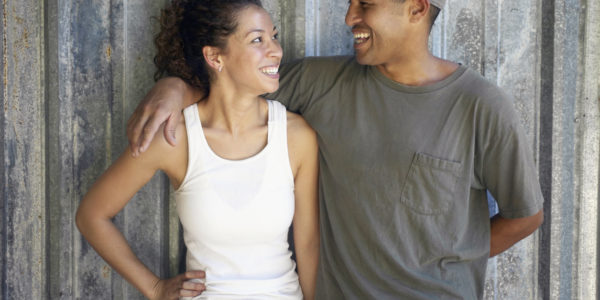 couple-with-his-arm-around-her-laughing-